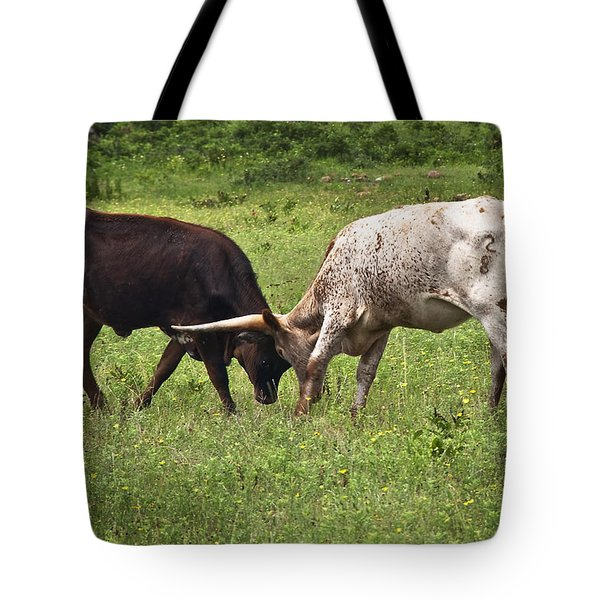 Tote Bag featuring the photograph Locking Horns by Tamyra Ayles