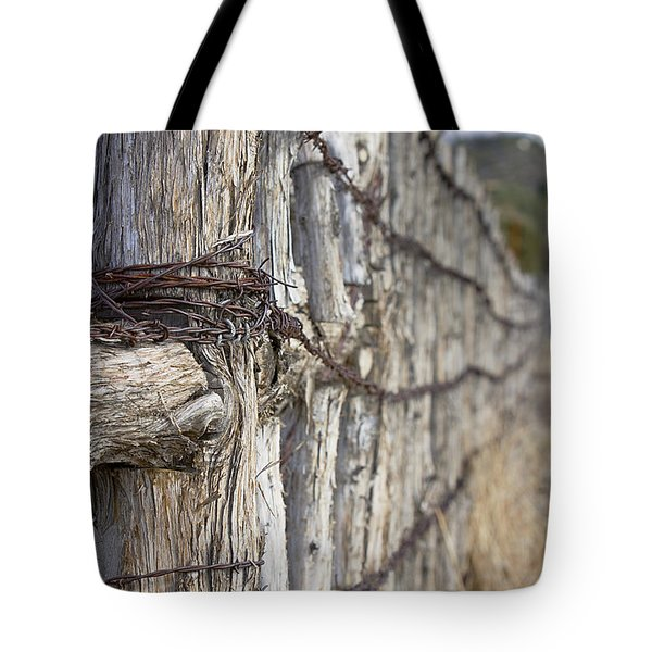 Tote Bag featuring the photograph Log And Wire Fence by Phyllis Denton