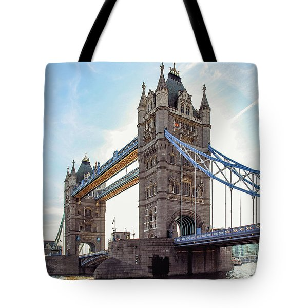Tote Bag featuring the photograph London - The Majestic Tower Bridge by Hannes Cmarits