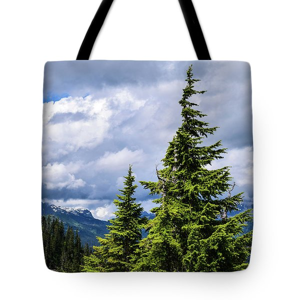 Lone Fir With Clouds Tote Bag