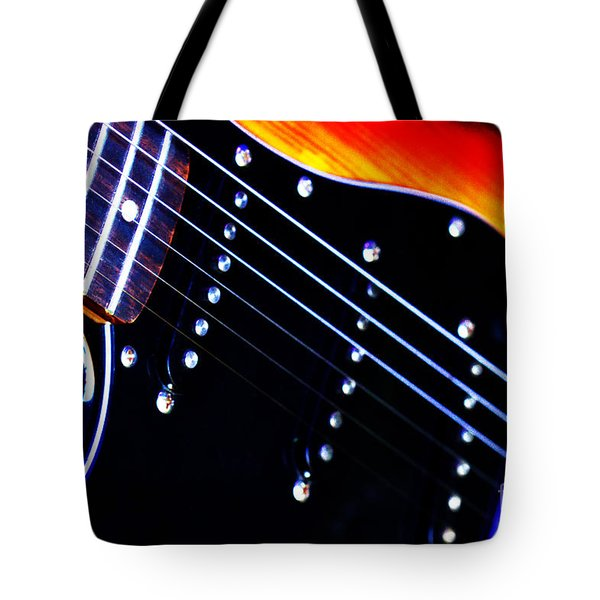 Tote Bag featuring the photograph Lone Guitar by Baggieoldboy