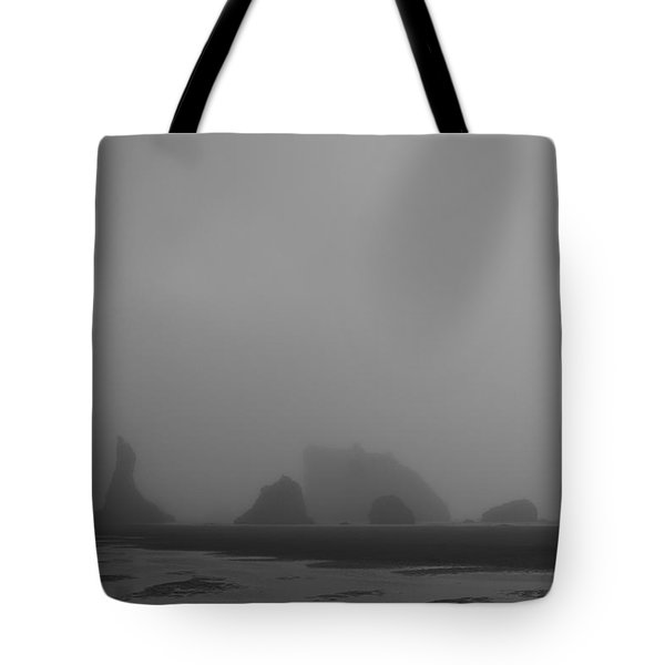 Tote Bag featuring the photograph Lone Rider by Dylan Punke