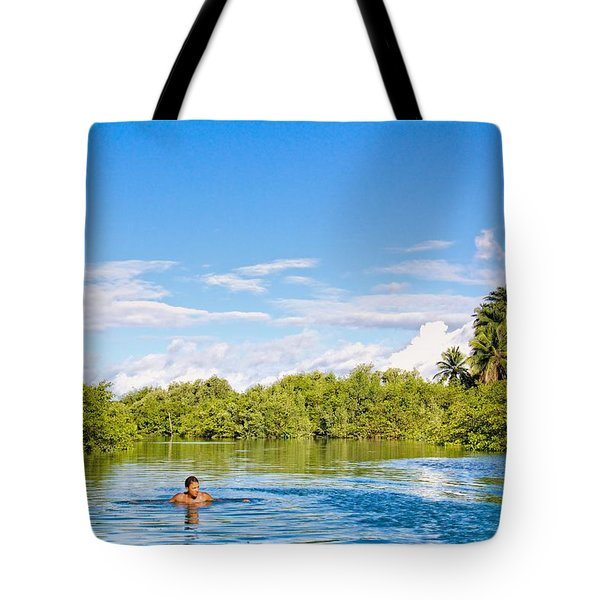 Tote Bag featuring the photograph Lone Swimmer by Kim Wilson