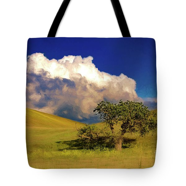 Tote Bag featuring the photograph Lone Tree With Storm Clouds by John A Rodriguez