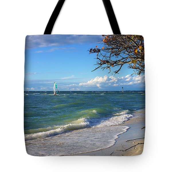 Lone Windsurfer At Wiggins Pass Tote Bag by Robb Stan