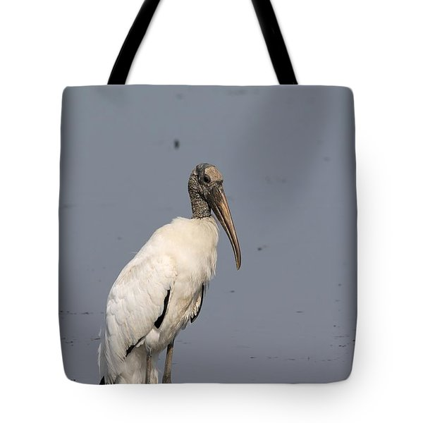 Tote Bag featuring the photograph Lone Woodstork by Kathy Gibbons