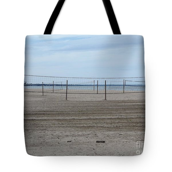 Lonely Beach Volleyball Tote Bag by Erick Schmidt