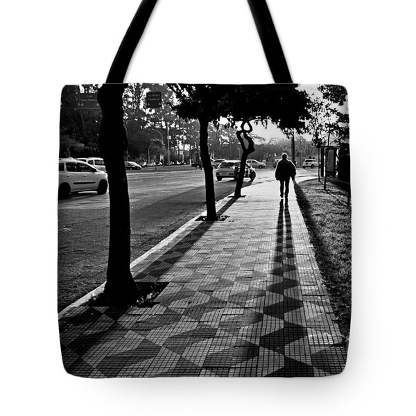 Lonely Man Walking At Dusk In Sao Paulo Tote Bag