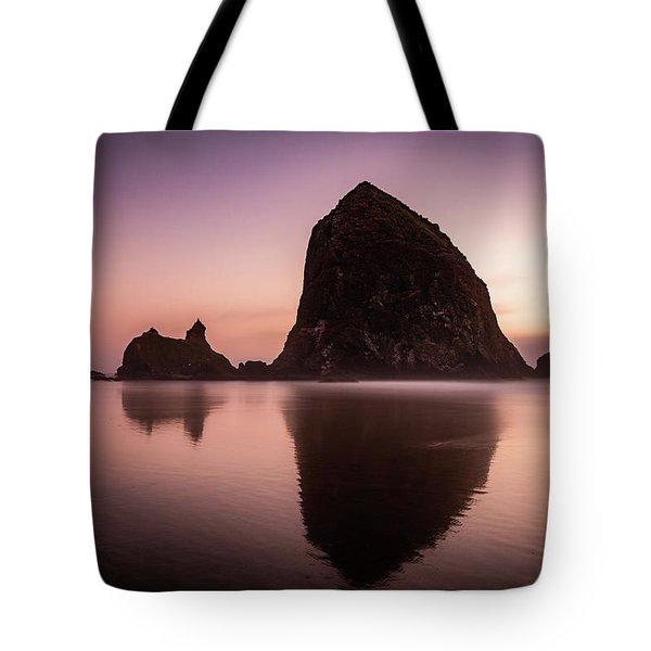 Long Exposure Of Haystack Rock At Sunset Tote Bag