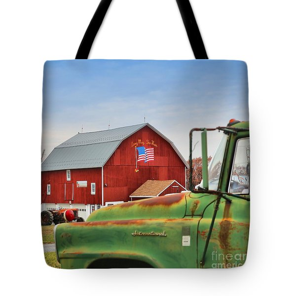 Tote Bag featuring the photograph Long May She Wave by DJ Florek