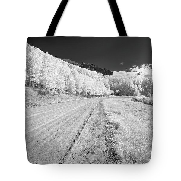 Tote Bag featuring the photograph Long Road In Colorado by Jon Glaser