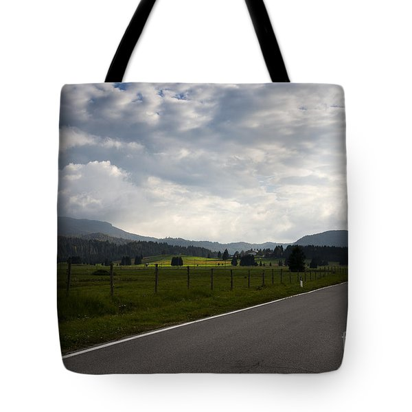 Tote Bag featuring the photograph Long Way Back by Yuri Santin