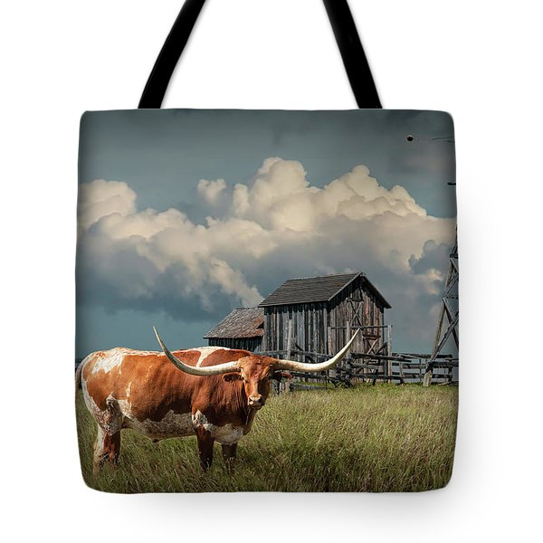 Longhorn Steer In A Prairie Pasture By Windmill And Old Gray Wooden Barn Tote Bag by Randall Nyhof