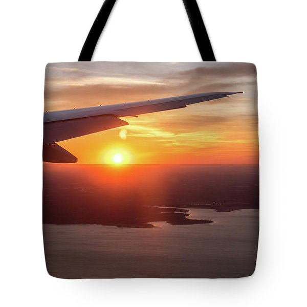 Looking At Sunset From Airplane Window With Lake In The Backgrou Tote Bag