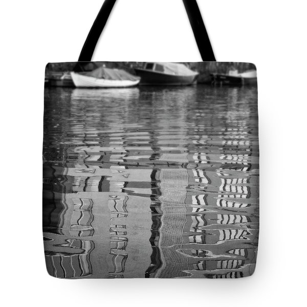 Looking In The Water Tote Bag