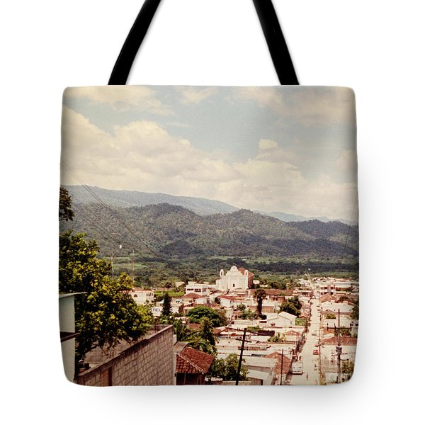Tote Bag featuring the photograph Looking Out by Charles McKelroy