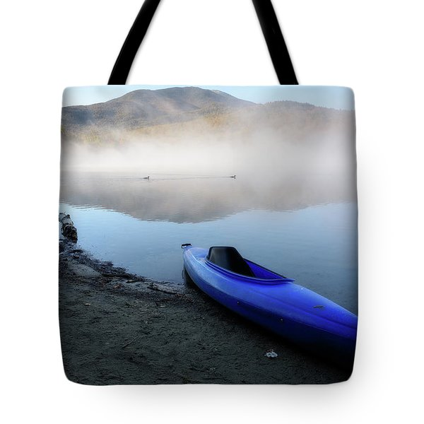 Tote Bag featuring the photograph Loons Crossing by Brad Wenskoski