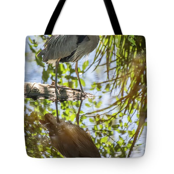 Tote Bag featuring the photograph Lost Lagoon Heron Reflections by Ross G Strachan