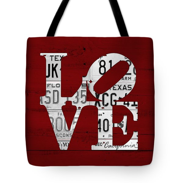Love Sign Vintage License Plates On Red Barn Wood Tote Bag by Design Turnpike