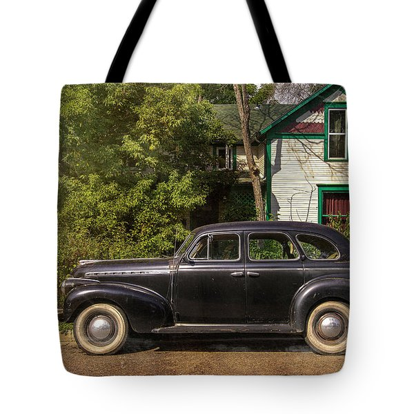 Tote Bag featuring the photograph Loveland Black Auto by Craig J Satterlee