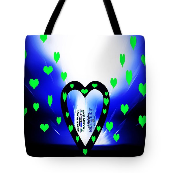 Tote Bag featuring the photograph Loving The Seattle Seahawks by Eddie Eastwood