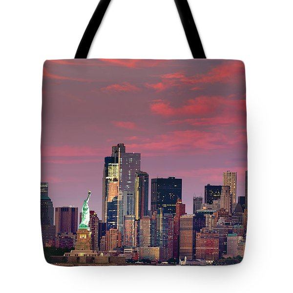 Tote Bag featuring the photograph Lower Manhattan In Pink by Emmanuel Panagiotakis