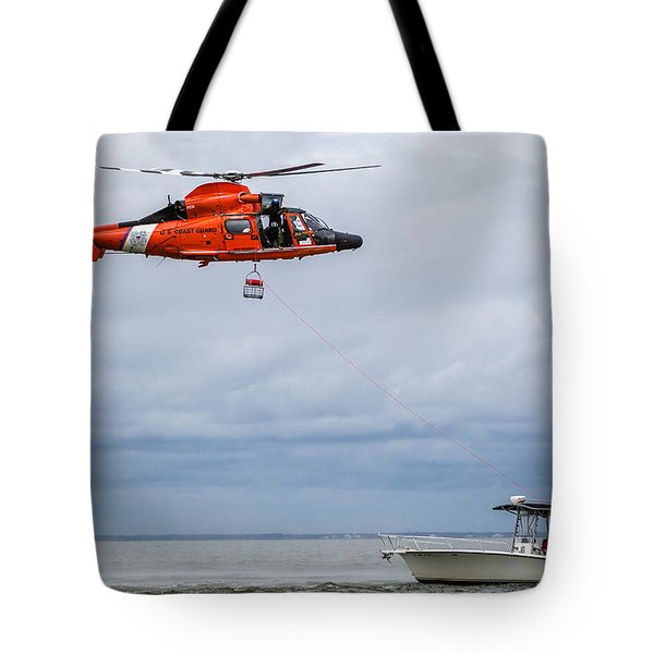 Tote Bag featuring the photograph Lowering Rescue Basket by Gregory Daley  PPSA