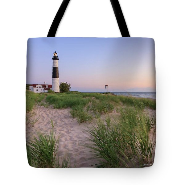 Tote Bag featuring the photograph Ludington Beach And Big Sable Point Lighthouse by Adam Romanowicz