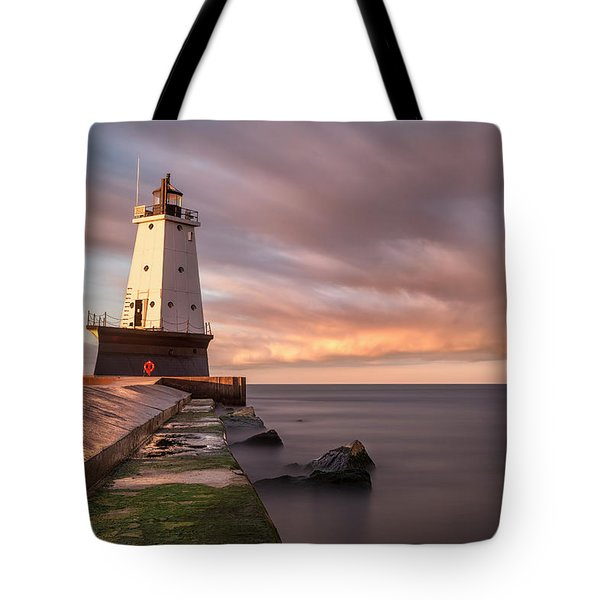 Tote Bag featuring the photograph Ludington Light Sunrise Long Exposure by Adam Romanowicz