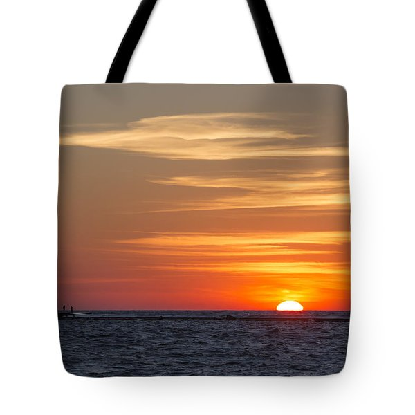 Tote Bag featuring the photograph Ludington North Breakwater Light At Sunset by Adam Romanowicz
