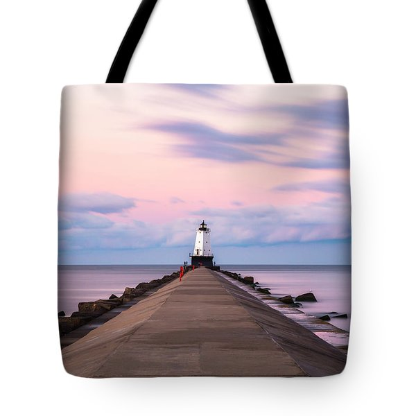 Tote Bag featuring the photograph Ludington North Breakwater Light Sunrise by Adam Romanowicz