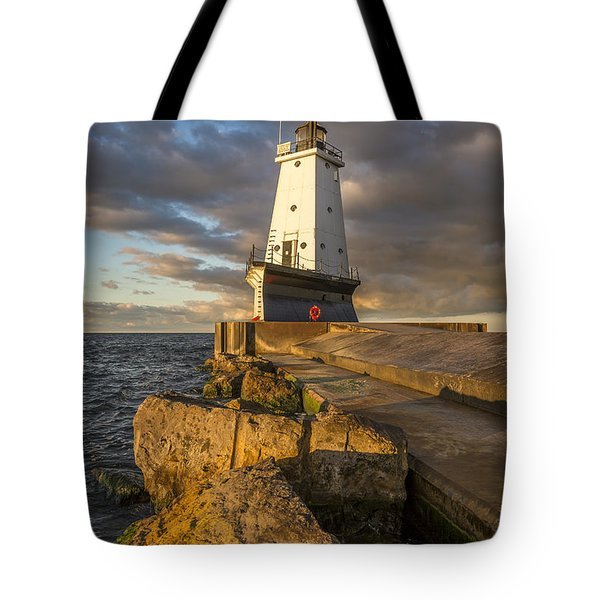 Tote Bag featuring the photograph Ludington North Breakwater Lighthouse At Sunrise by Adam Romanowicz