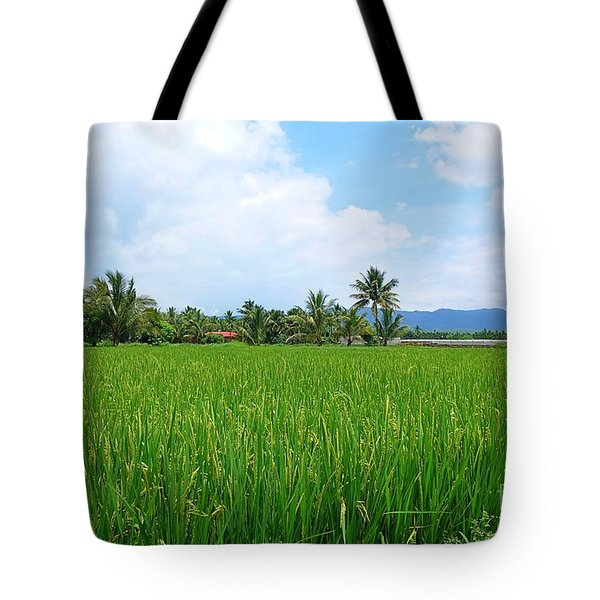 Lush And Green Rice Field With Palm Trees Tote Bag