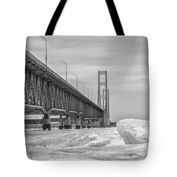 Tote Bag featuring the photograph Mackinac Bridge Icy Black And White  by John McGraw