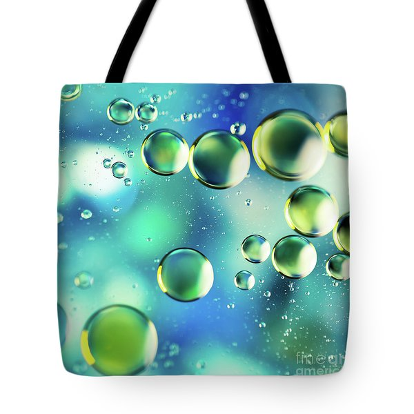 Tote Bag featuring the photograph Macro Water Droplets Aquamarine Soft Green Citron And Blue by Sharon Mau