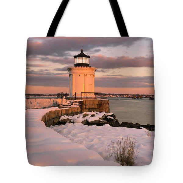Tote Bag featuring the photograph Maine Bug Light Lighthouse Snow At Sunset by Ranjay Mitra