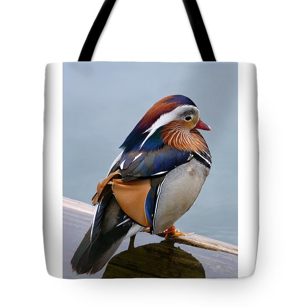 Tote Bag featuring the photograph Male Mandarin Duck Perching On Submerged Plank by Menega Sabidussi