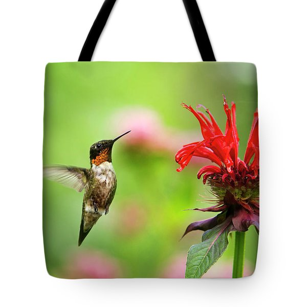 Male Ruby-throated Hummingbird Hovering Near Flowers Tote Bag