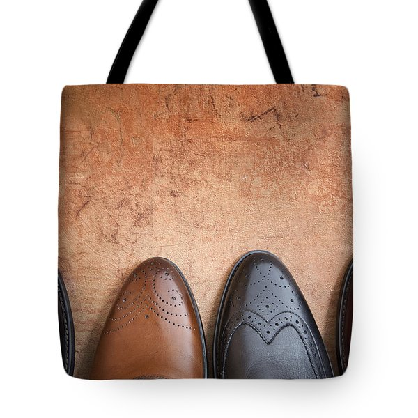 Tote Bag featuring the photograph Male Shoes by Andrey  Godyaykin