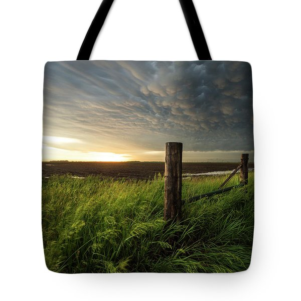 Tote Bag featuring the photograph Mammatus Sunset by Aaron J Groen