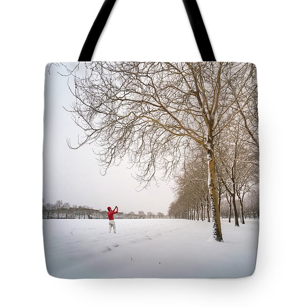 Man In Red Taking Picture Of Snowy Field And Trees Tote Bag