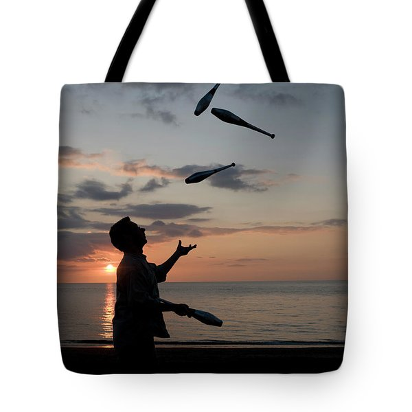 Man Juggling With Four Clubs At Sunset Tote Bag