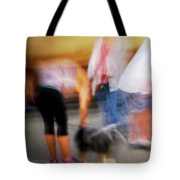 Woman Playing With Dog Tote Bag