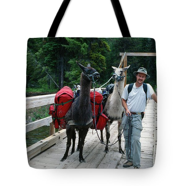 Man Posing With Two Llamas On Wilderness Drawbridge Tote Bag by Jerry Voss