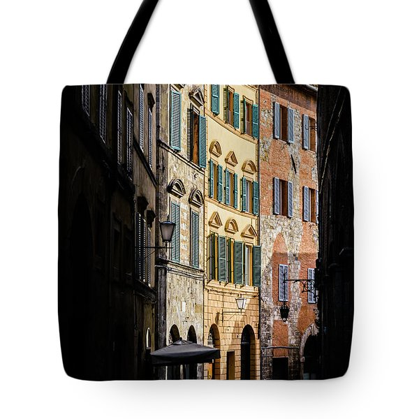 Man Walking Alone In Small Street In Siena, Tuscany, Italy Tote Bag