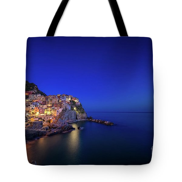 Tote Bag featuring the photograph Manarola Village During Blue Hour At Night by IPics Photography