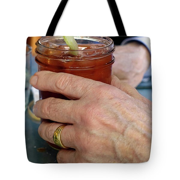 Mans Hand Holding Bloody Mary  Tote Bag by Beth Wolff