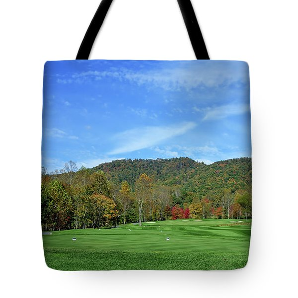 Tote Bag featuring the photograph Maple Red by Claire Turner