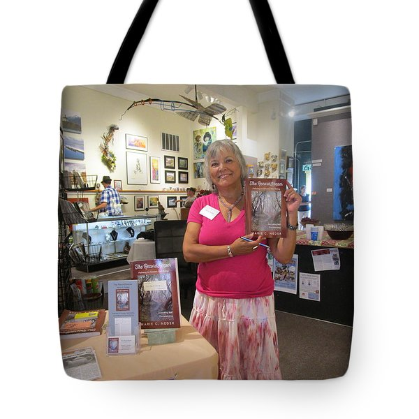 Tote Bag featuring the photograph Marie And The Recordkeeper by Marie Neder