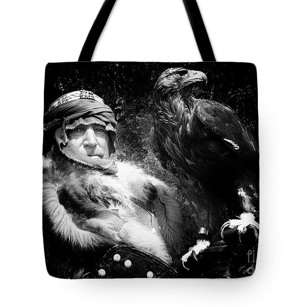 Tote Bag featuring the photograph Medieval Fair Barbarian And Golden Eagle by Bob Christopher